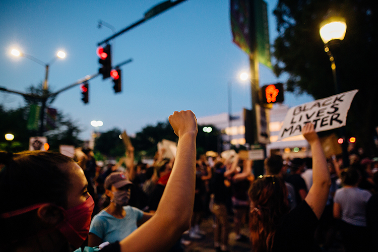 People raise their fists, voices and signs in support of the Black Lives Matter movement during a June 2 protest in downtown Chattanooga, Tenn., that drew hundreds of participants to call for racial equality and justice and to pay tribute to George Floyd, who died May 25 after a Minneapolis police officer kneeled on his neck during an arrest. (Photo courtesy of Kelly M. Lacy/Pexels)