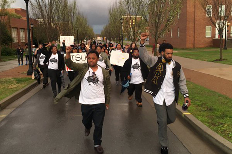 Student protesters march to the executive residence of MTSU President Sidney A. McPhee on March 24, 2016. They demonstrated in favor of taking Confederate general Nathan Bedford Forrest's name off the ROTC building on campus. (Photo by Lauren Frederick and submitted by Albert Gore Research Center)