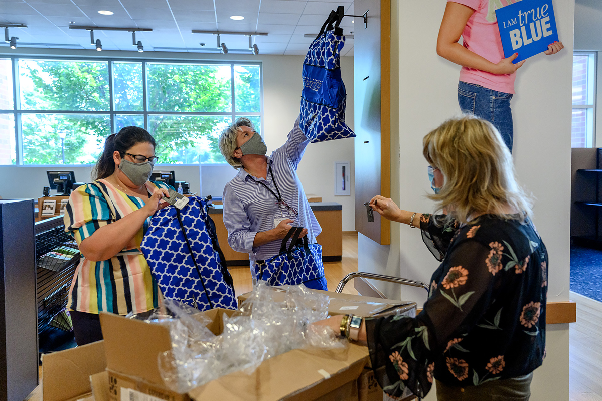 MTSU Phillips Bookstore regional manager Greer Hallmark, left, assistant store manager Melisa Warner and new manager Natalie Karousatos tag and hang new-arriving merchandise Tuesday, June 16, on the first day the store reopened. The store is operated by Barnes & Noble College, and will be open from 10 a.m. to 2 p.m. Monday through Friday for the present time. (MTSU photo by J. Intintoli)