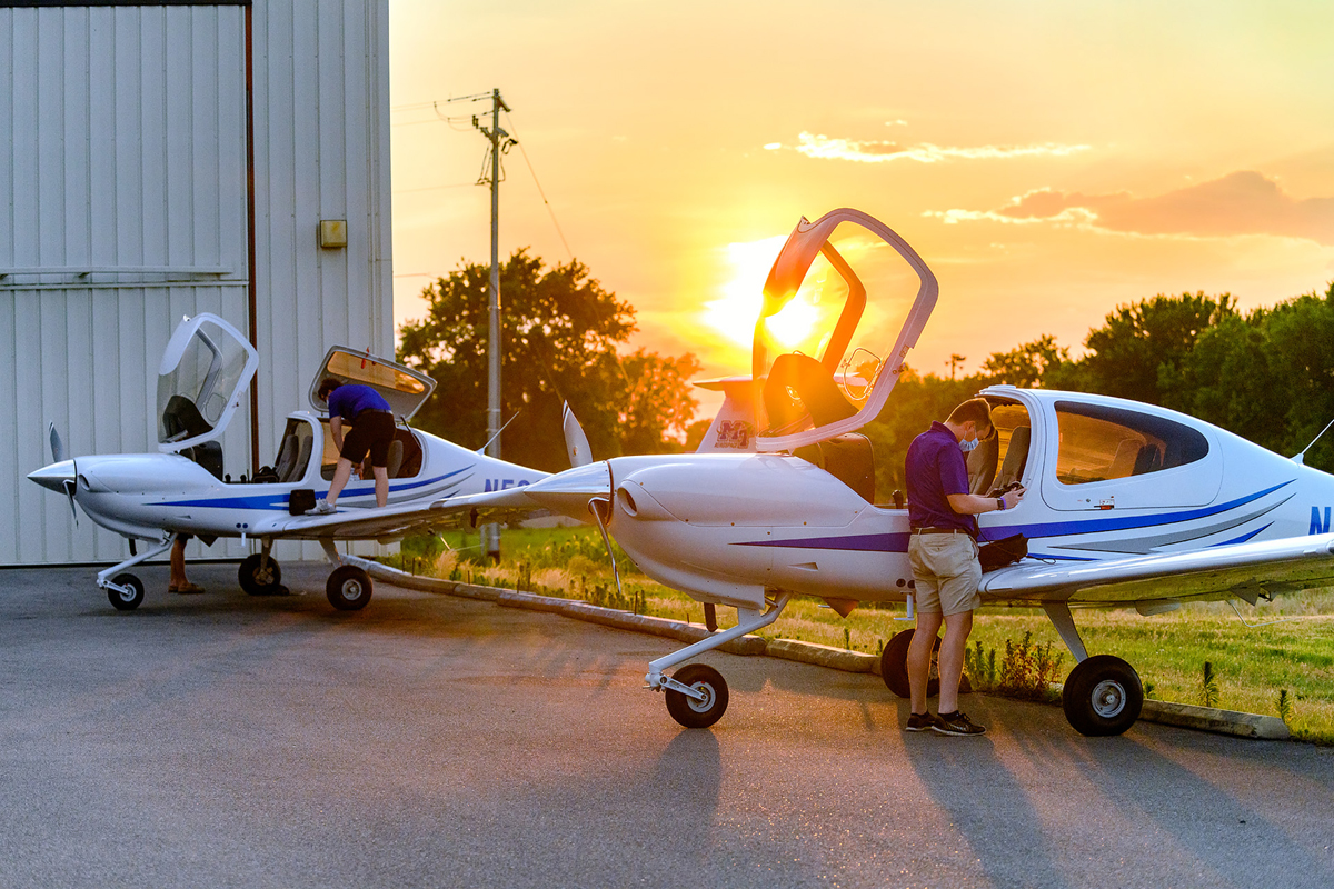 As sunset approaches, MTSU aerospace students and certified flight instructors Ryan Patterson, partially hidden left. Cole Ferraro and Copher Kashif perform their final checks and unloading after flying in two new Diamond Aircraft on Friday, June 19, from Michigan near the Canadian border. MTSU purchased six new planes and is having 13 planes refurbished. (MTSU photo by J. Intintoli)