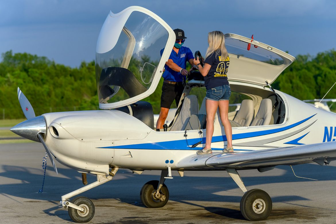 MTSU senior and certified flight instructor Jesse Rigsby and junior aerospace professional pilot major McKayla Petty perform maintenance and check off their list after flying a new Diamond Aircraft back to Murfreesboro Airport Friday, June 19. Two new planes and a refurbished aircraft flew in late in the day. (MTSU photo by J. Intintoli)