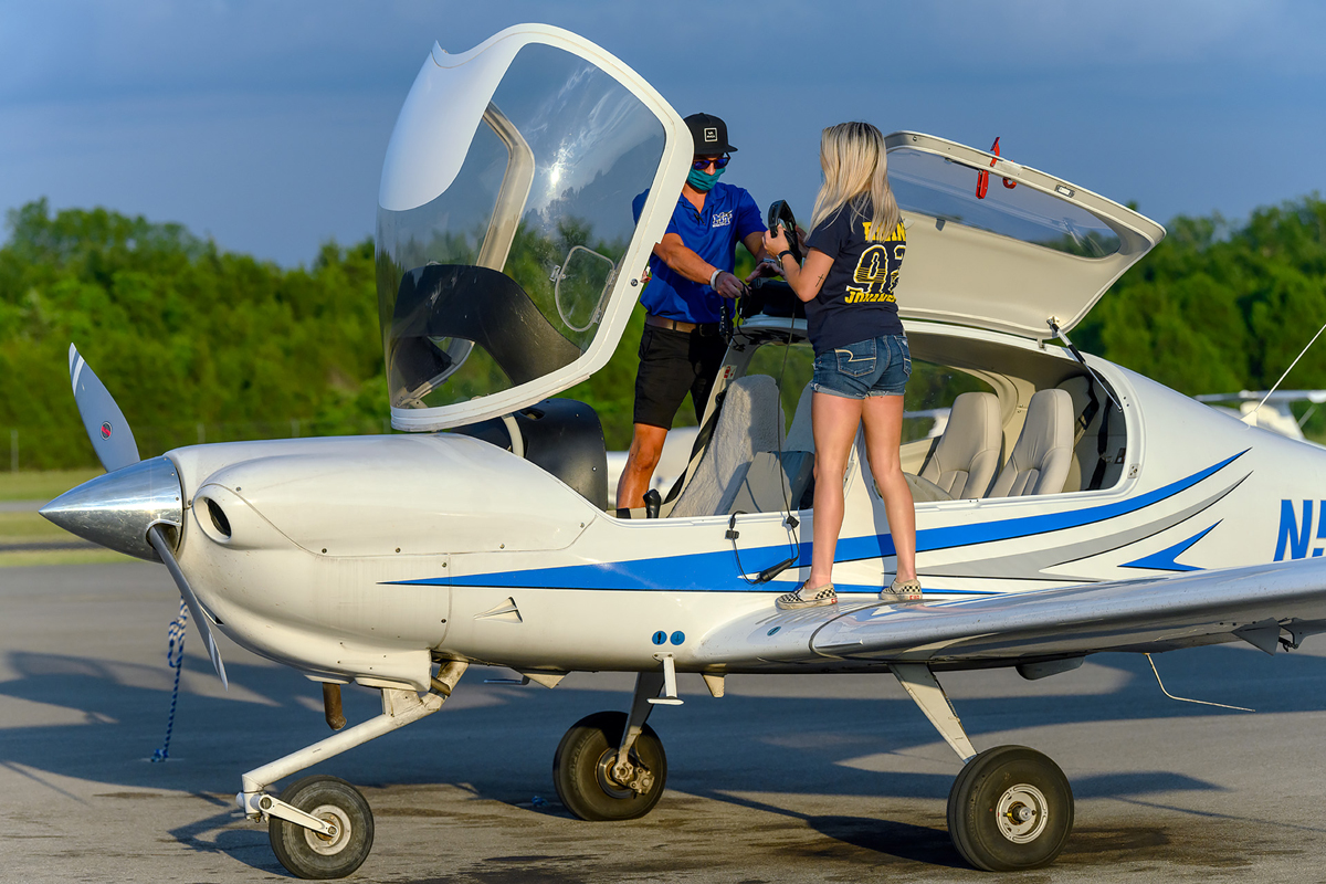 MTSU flight instructors and aerospace students perform maintenance and check off their to-do list after flying a new Diamond Aircraft back to Murfreesboro Airport in this June 2020 photo. Aerospace is experiencing amazing growth in recent years.(MTSU file photo by J. Intintoli)