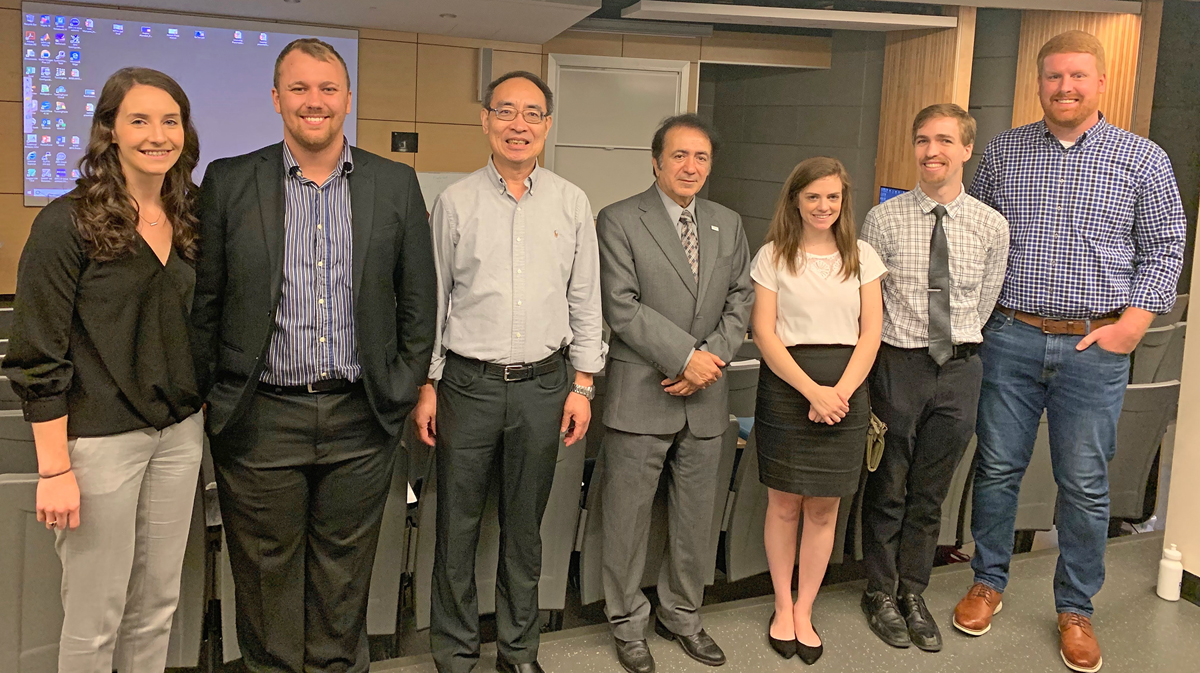Former MTSU actuarial science graduate students Courtney DeClerk, left, and Curtis Barker, professor Don Hong, Master of Science in Professional Science director Saeed Foroudastan and students Wren Tackett, David Phillips and Brennan Stender pause after attending the MSPS August 2019 presentations in the Science Building. The students served internships with partnering businesses before graduating during the summer term, (Submitted photo)
