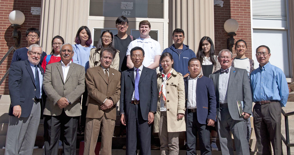 Along with MTSU actuarial science students (back row), university administrators and faculty Peter Cunningham, front left, Abdul Khalig and Saeed Foroudastan welcome China partner school Ningbu University delegation members Feirong Wang, Lishuang Wu and Weiping Li, with MTSU's Don Nelson and Don Hong also shown. Ningbu annually sends a delegation to visit MTSU to discuss exchange program issues or participate in a graduation ceremony. (Submitted photo)