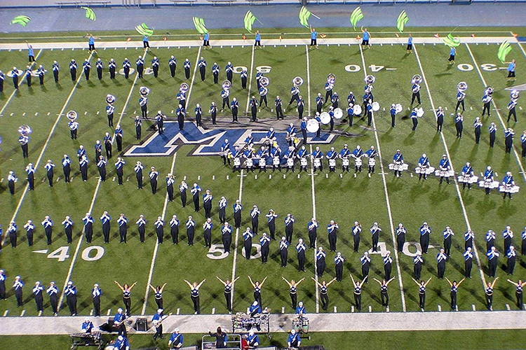 The MTSU Band of Blue performs on Jones Field inside the university's Floyd Stadium in this recent file photo. The MTSU School of Music has canceled the 2020 Contest of Champions, the nation's longest-running marching band competition, set for this fall and hosted by the Band of Blue, to help keep high school competitors and their supporters from across the region safe in the ongoing pandemic. (MTSU photo courtesy of School of Music)
