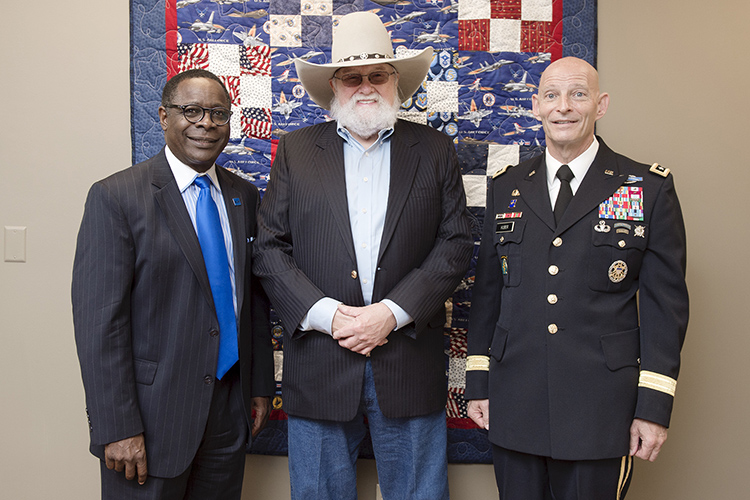 Pictured in this 2015 file photo, from left, are MTSU President Sidney A. McPhee, country music icon Charlie Daniels and retired Lt. Gen. Keith M. Huber, senior advisor for veterans and leadership initiatives, at the opening of the MTSU Veterans and Military Family Center. The center would be named in honor of Daniels and his, wife, Hazel, a year later for their support of military veterans. (MTSU file photo by J. Intintoli)
