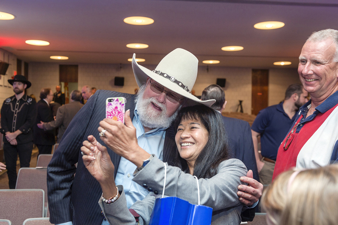 Country music legend Charlie Daniels shares a selfie with Many Bears Grinder, then-Tennessee Department of Veterans Affairs commissioner, at the official opening ceremony of the MTSU Veterans and Military Family Center inside Keathley University Center. The center would be renamed in honor of Daniels and his wife, Hazel, the following year. Daniels died Monday, July 6, at Summit Medical Center in Hermitage, Tenn. (MTSU file photo by J. Intinoli)