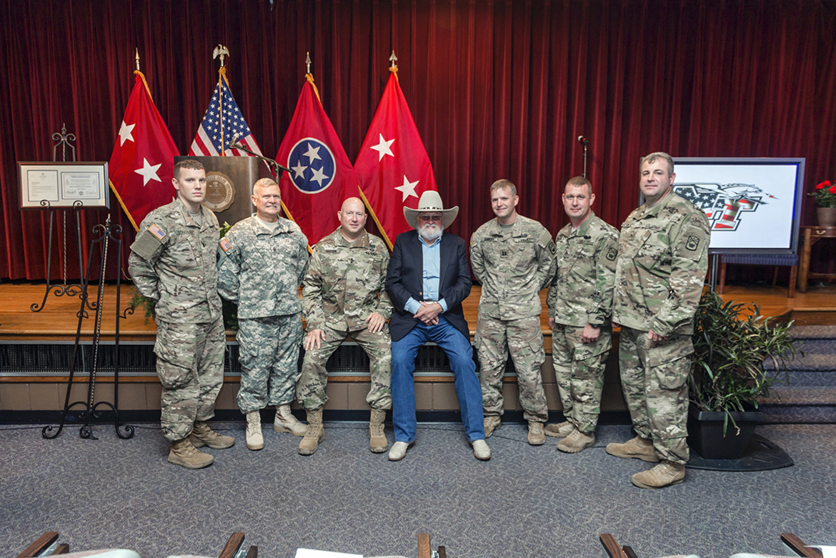 At the opening of the MTSU Veterans and Military Family Center, Charlie Daniels, center, poses with MTSU alumnus and then-Tennessee National Guard adjutant general Max Haston, third from left, and other military members in the KUC Theater. A year later, MTSU renamed the center in honor of Daniels and his wife, Hazel. Daniels died Monday, July 6, at Summit Medical Center in Hermitage, Tenn. (MTSU file photo J. Intintoli)
