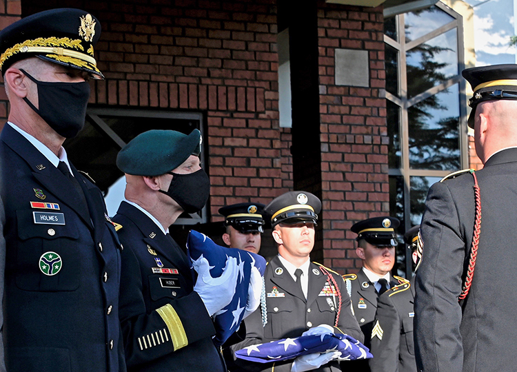 Retired Army Lt. Gen. Keith Huber, MTSU's senior advisor for veterans and leadership initiatives, second from left, holds the folded American flag that had draped the coffin of country music icon Charlie Daniels. Huber would later present the flag to Daniels' widow, Hazel, during a memorial service Tuesday in the couple's hometown of Mt. Juliet, Tenn. Daniels, who died Monday at age 83, is patron of the university's veterans center. At far left is Army Maj. Gen. Jeff Holmes, the state's adjutant general. (MTSU photo by Andrew Oppmann)