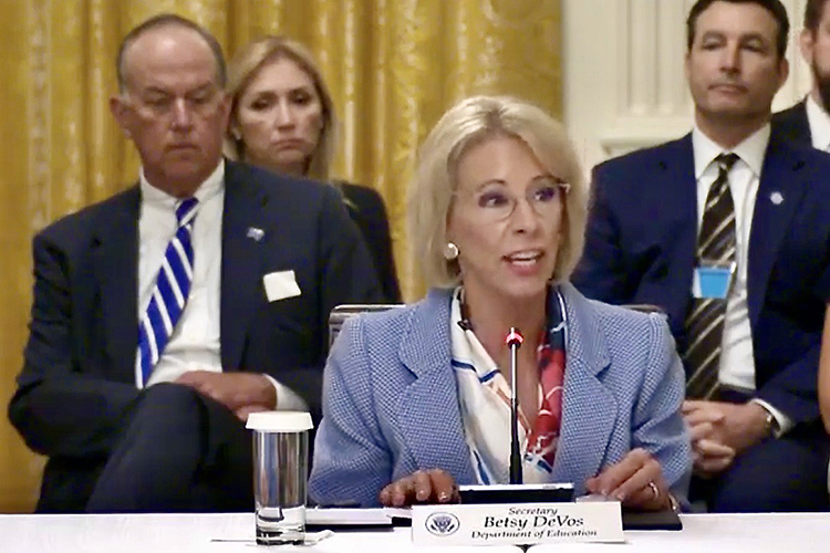 A screenshot from a video showing MTSU Board of Trustees Chairman Stephen B. Smith, back left, watching Education Secretary Betsy DeVos speak at a White House panel Tuesday on plans to reopen the nation's schools and universities this fall.