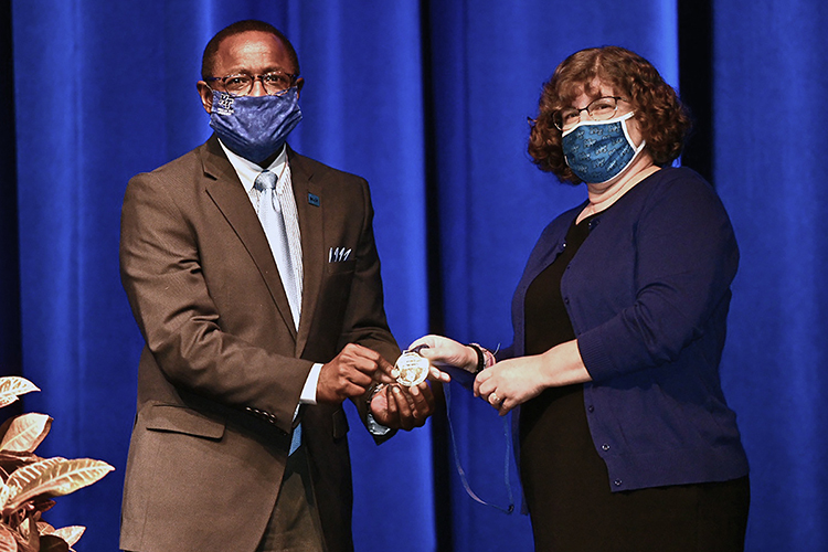 MTSU President Sidney A. McPhee, left, presents Department of Biology professor Mary Farone with the university's highest faculty honor, the MTSU Foundation Career Achievement Award, Thursday, Aug. 20, at the 2020 Fall Faculty Meeting in Tucker Theatre. The annual event, held virtually this year because of the pandemic, saluted Farone's 24 years of teaching, research and service to students and honored 11 more faculty award recipients for their accomplishments in and outside the classroom. (MTSU photo by J. Intintol)