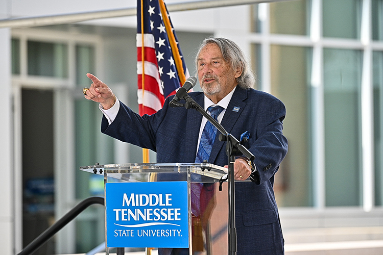 "Harold ""Terry"" Whiteside, dean of the MTSU College of Behavioral and Health Sciences, speaks at the Aug. 18 ribbon-cutting for the new Academic Classroom Building that will house the disciplines of criminal justice, psychology and social work. (MTSU photo by J. Intintoli)"