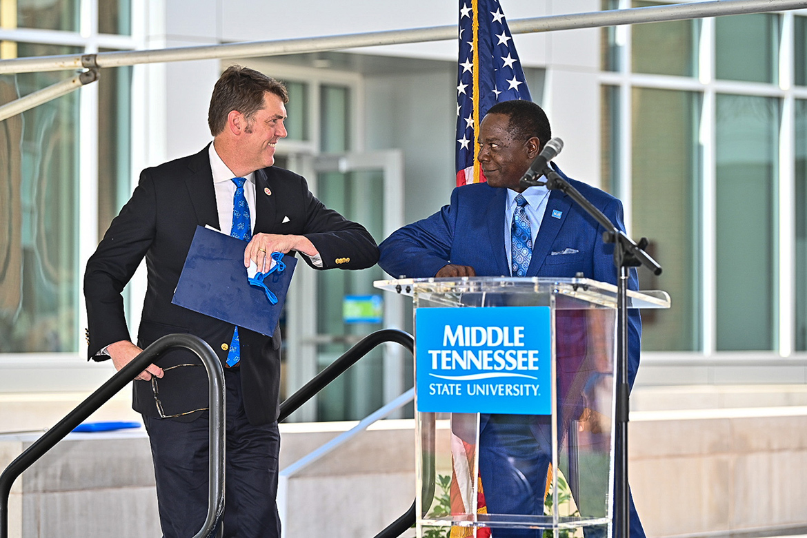 State Sen. Shane Reeves, left, and MTSU President Sidney A. McPhee share an elbow bump prior to Reeves' address to the audience at the Aug. 18 ribbon-cutting for the university's new Academic Classroom Building. (MTSU photo by J. Intintoli)