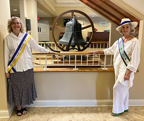 Dr. Antoinette van Zelm, left, associate director of MTSU's Center for Historic Preservation, and Andrea Loughry, vice chair of the Rutherford Arts Commission, pose at the First United Methodist Church in Murfreesboro with the bell that was rung Aug. 28, 1920, to celebrate passage of the 19th Amendment. van Zelm and Loughry rang the bell Aug. 11, 2020, to celebrate the centennial of the event. (Photo submitted)