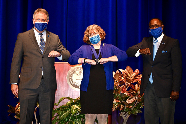 From left, MTSU Provost Mark Byrnes, biology professor Mary Farone and university President Sidney A. McPhee pose for a photo after Farone was presented with the 2020 Career Achievement Award as part of the Virtual Fall Faculty Meeting filmed Thursday, Aug. 20, from Tucker Theatre. Normally attended by hundreds of faculty and staff, this year's event was held virtually for the first time because of the coronavirus pandemic. (MTSU photo by J. Intintoli)