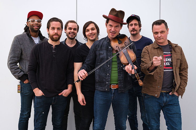 Members of the multi-Grammy-winning Americana string band Old Crow Medicine Show are shown in this 2019 publicity file photo. From left are Jerry Pentecost, Joe Andrews, Robert Price, Charlie Worsham (who is no longer with the band), Ketch Secor, Cory Younts and Morgan Jahnig. (Photo courtesy of Old Crow Medicine Show)