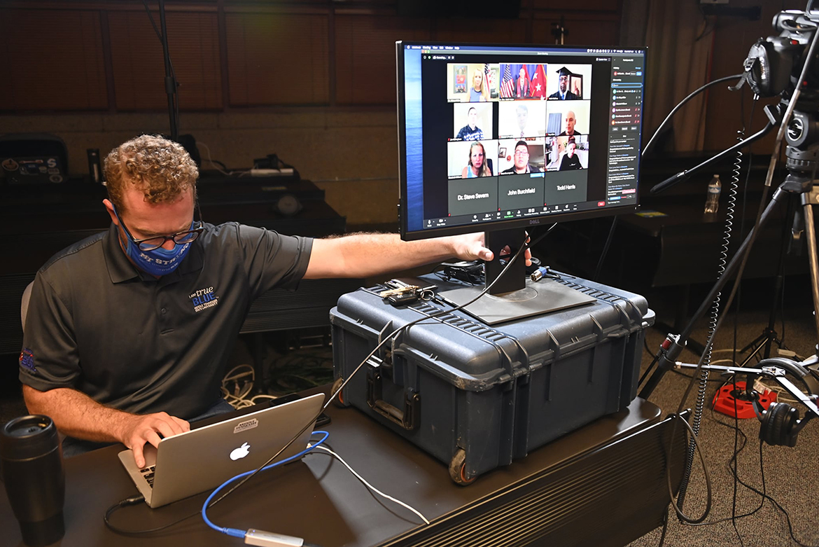 John Goodwin, strategic communications manager in the Division of Marketing and Communications, monitors the Zoom livestream featuring some of the summer graduates participating in the Wednesday, Aug. 5, virtual Graduating Veterans Stole Ceremony. (MTSU photo by Andrew Oppmann)