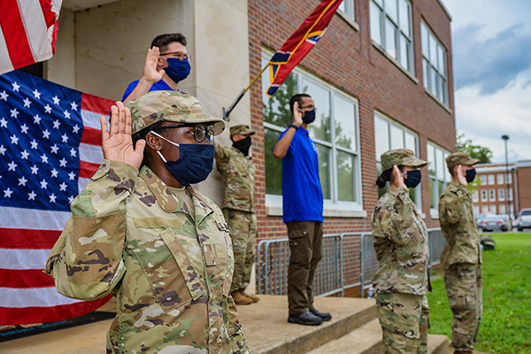 Cadet Wilnie FanFan, front left, recites the Army oath as she and four others are sworn in as an contracted ROTC cadet Thursday, Aug. 27, outside Forrest Hall. Others reciting the oath include Christina Sayaboun, second from left, and Seth Pilgrim; and Caleb Watts, back row left, and Sebastian Kernisant. (MTSU photo by Andy Heidt)
