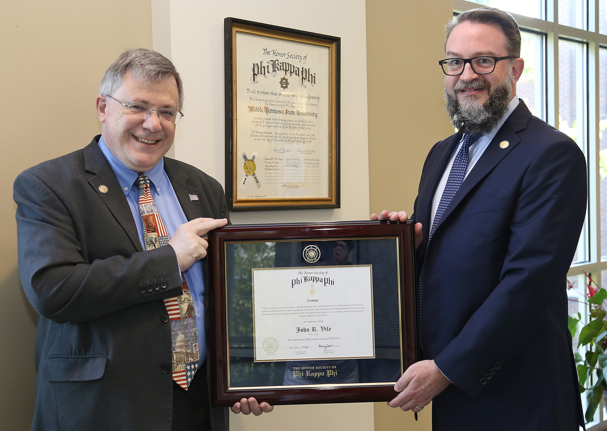 MTSU Honors College Dean John Vile, left, and Associate Dean Philip Phillips hold The Honor Society of Phi Kappa Phi Scholar Award for 2020-22 for Vile's excellence in teaching, research and public service in a career spanning 40 years. Phillips nominated Vile for the Honor. (MTSU photo by Marsha Powers)