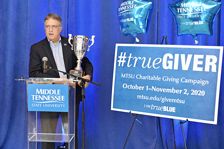MTSU Provost Mark Byrnes holds the Provost Cup during the kickoff of the 2020-21 MTSU Employee Charitable Giving Campaign held recently in the atrium of the Cope Administration Building. The Provost Cup is a friendly competition between academic units that is awarded to the college with the highest percentage of employee participation. The Jones College of Business has won the cup for seven straight years. (MTSU photo by Andy Heidt)