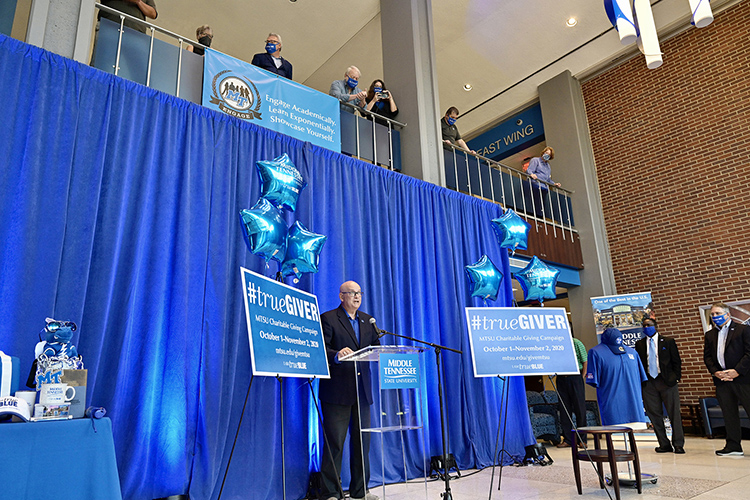 Andrew Oppmann, vice president of marketing and communications and spokesperson for the 2020-21 MTSU Employee Charitable Giving Campaign, gives remarks during the recent campaign kickoff in the atrium of the Cope Administration Building as other campaign volunteers look on. (MTSU photo by Andy Heidt)