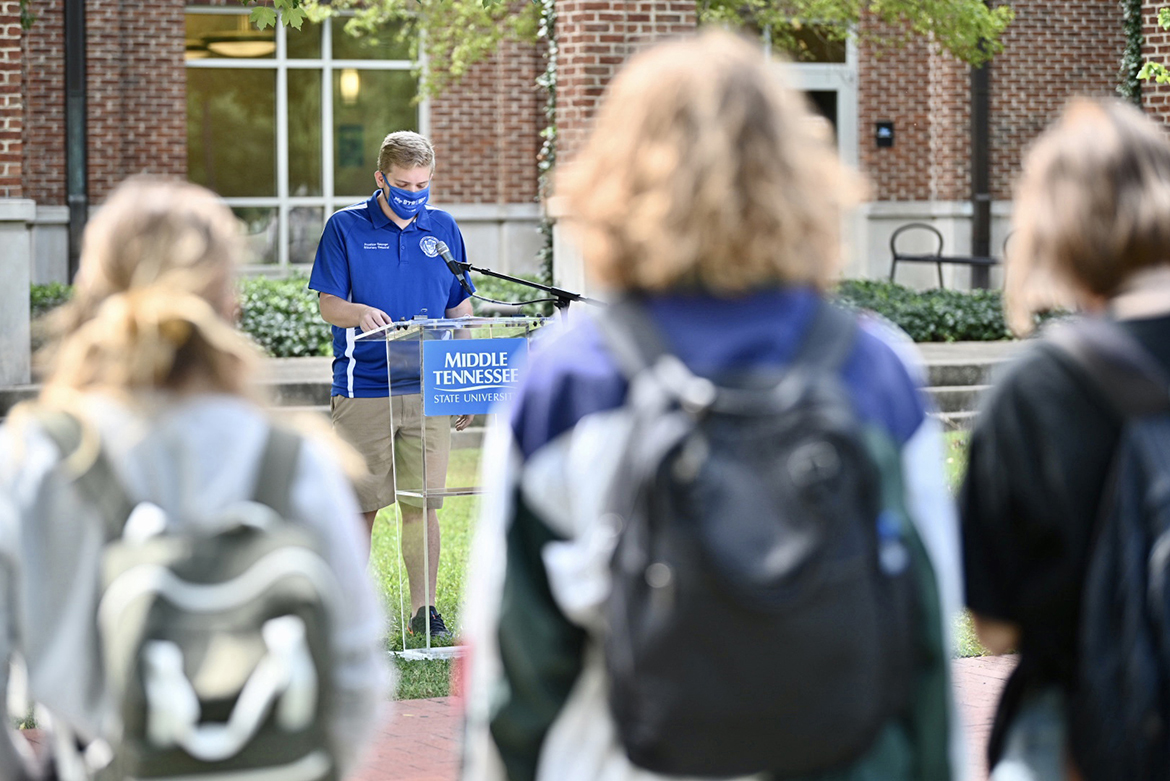 Preston George, a junior political science major from Mount Juliet, Tennessee, reads part of the U.S. Constitution outside the University Honors College as other students look on as part of MTSU's 2020 Constitution Day celebration. (MTSU photo by J. Intintoli)