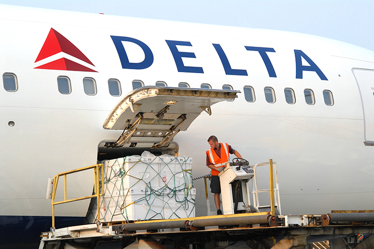 A Delta Air Lines worker processes cargo in this undated file photo. (Photo courtesy of Delta Air Lines)