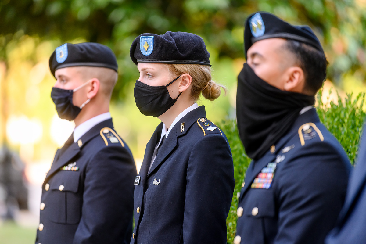 MTSU ROTC cadets Jordan Anderson, left, of Morristown, Tenn., Maggie Potter of Maryville, Tenn., and Brian Acosta of Murfreesboro stand at attention Friday, Sept. 11, at the Veterans Memorial as they await the reading of the 9/11 timeline from the events that transpired on Sept. 11, 2001. Cadets reading the timeline has been a tradition at the annual ceremony. (MTSU photo by J. Intintoli)