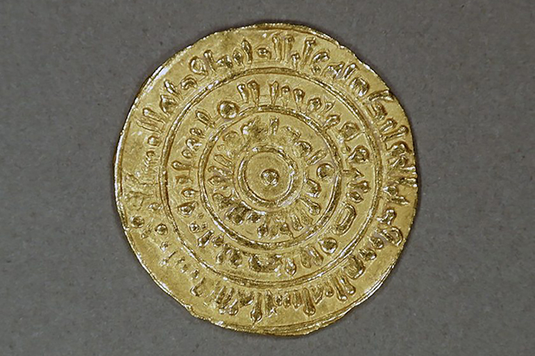 "This gold coin, estimated to date to the 9th century, was struck at a mint in Misr, Egypt, during the Almoravid Dynasty. The writing on it reads, in part, ""There is no God but God. Mohammed is the prophet of God."" The coin is part of the ""Caravans of Gold, Fragments of Time"" exhibit at the Smithsonian Institution's National Museum of African Art in Washington, D.C. (Photo submitted)"