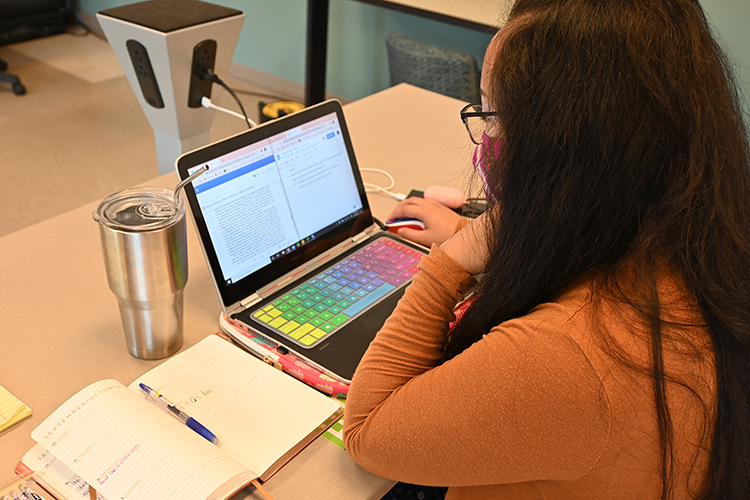 "Juvi Mallari, a graduate assistant and student pursuing a degree in higher education administration and supervision, works in the College of Education ""Teacher Candidate HUB"" while using one of the room's many power towers to charge her phone on Sept. 23. 2020. (MTSU photo by Stephanie Barrette)"