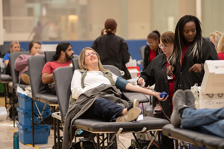 "MTSU donors relax while American Red Cross technicians take their pints of blood during the 2019 annual blood drive competition with Western Kentucky University in this file photo. MTSU is conducting its own ""Bleed Blue to Beat the COVID-19 Blues"" blood drive Sept. 28-30 in the North Boulevard Church of Christ gymnasium in the wake of pandemic-related scheduling changes. (MTSU file photo by James Cessna)"