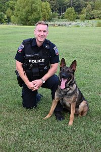 Officer Zachery Brooker, K9 handler and patrol specialist with the Middle Tennessee State University Police Department, and his K9 Bobby are all smiles while together on campus on Sept. 14, 2020. (MTSU photo by Stephanie Barrette)