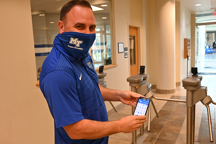 Andy Allgrim, campus recreation's facility coordinator, demonstrates how to use MTSU's campus rec app. (MTSU photo by Stephanie Barrette)