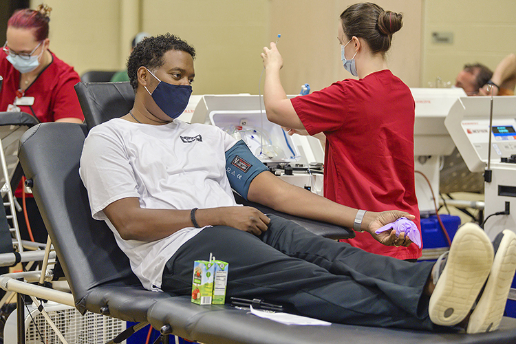 """Rodney Francis of Murfreesboro, Tenn., prepares to donate blood with the help of an American Red Cross technician at MTSU's three-day """"Bleed Blue to Beat the COVID-19 Blues"""" blood drive, held Sept. 28-30 at the neighboring North Boulevard Church of Christ gymnasium. Supporters donated 269 units of blood during the event, potentially helping up to 765 more people across Tennessee and parts of Kentucky, Illinois and Missouri. (MTSU photo by Andy Heidt)"""