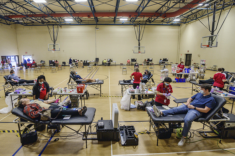 """American Red Cross personnel help donors give blood at MTSU's three-day """"Bleed Blue to Beat the COVID-19 Blues"""" blood drive, held Sept. 28-30 at the neighboring North Boulevard Church of Christ gymnasium. Supporters donated 269 units of blood during the event, potentially helping up to 765 more people across Tennessee and parts of Kentucky, Illinois and Missouri. (MTSU photo by Andy Heidt)"""