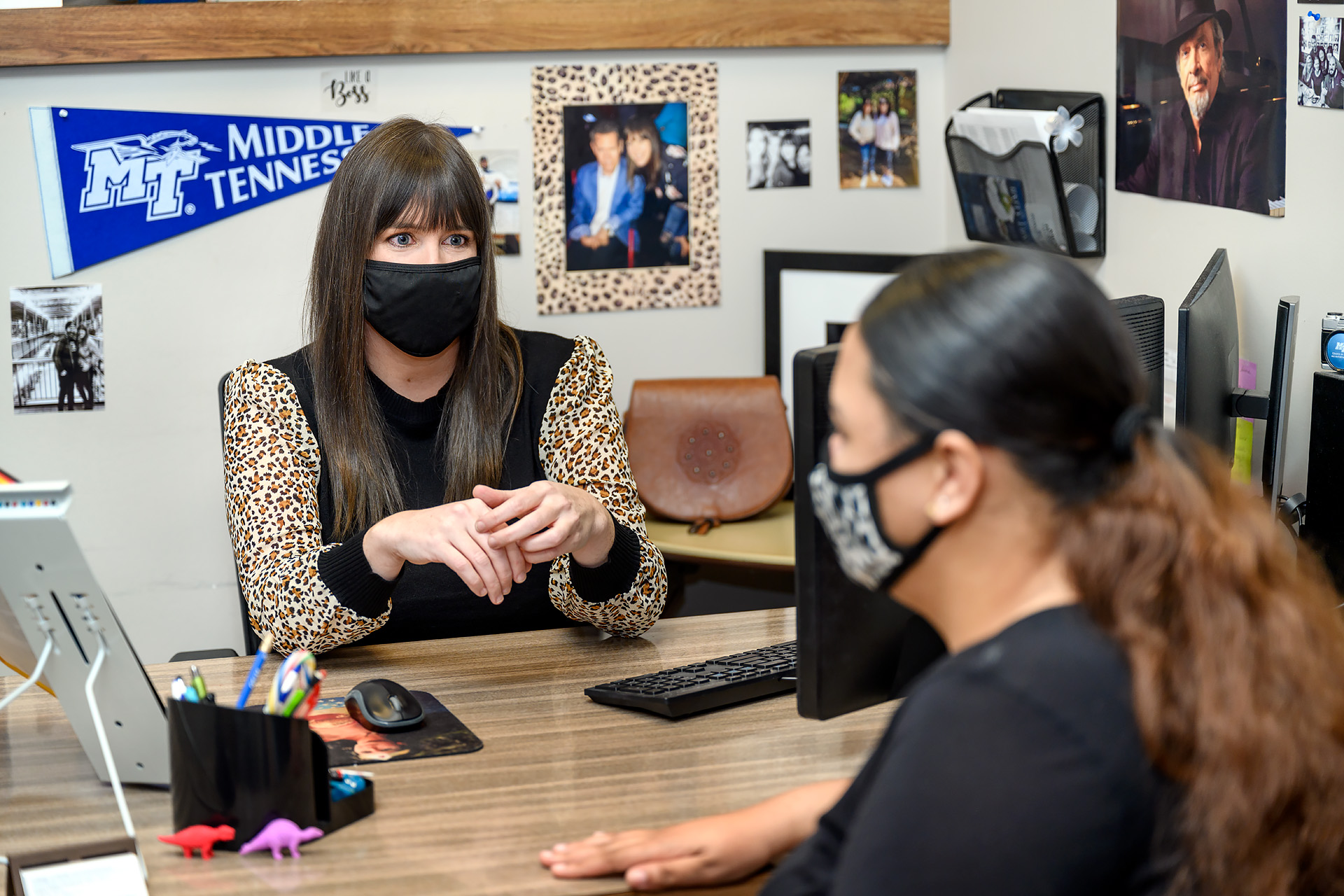 Laura Helen Husband adviser profile portrait in her Bragg building office with student Maleea Webb. (Photo: J. Intintoli)