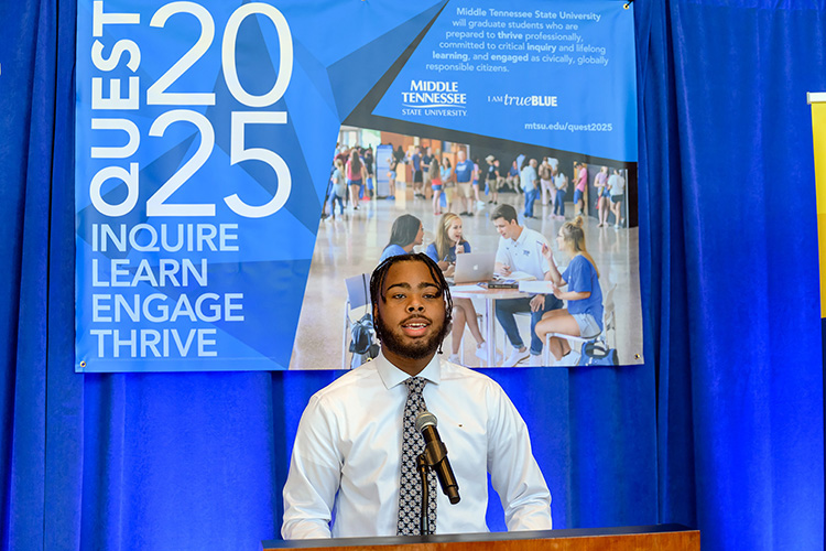 MTSU student Will Rosser, a marketing major from Memphis, Tennessee, and an Office of Student Success peer mentor to incoming freshmen this fall, expresses his excitement about the Quest 2025 initiative announced via livestream Wednesday, Oct. 21, from the lobby of the Cope Administration Building. (MTSU photo by J. Intintoli)