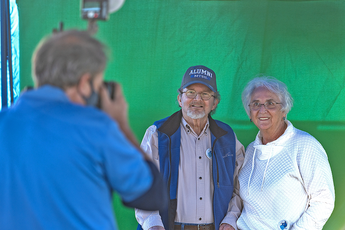 MTSU alumni Joe and Ann Nunley have their photo taken by David Schenk of Schenk Photography at the MTSU keepsake photo booth Thursday, Oct. 1, near the Greenland Drive parking lot adjacent to Murphy Center. Joey Nunley earned MTSU degrees in 1969, '74 and '80. Ann Nunley earned degrees in '69 and '73. (MTSU photo by Cat Curtis Murphy)
