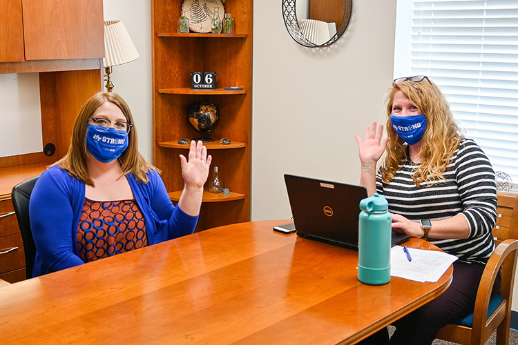 Allison Martenson, left, business process specialist, and Lyndsey Bennett, right, senior graduate analyst, share lunch and a wave at the MTSU College of Graduate Studies on Oct. 15, 2020. (MTSU photo by Stephanie Barrette)