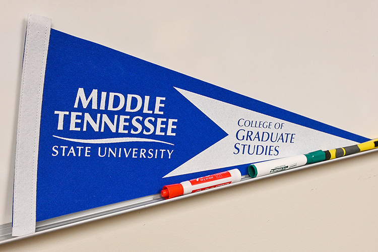 An MTSU College of Graduate Studies flag sits on the whiteboard in Sarah Hendrix's office in the Sam Ingram Building on Oct. 15, 2020. (MTSU photo by Stephanie Barrette)