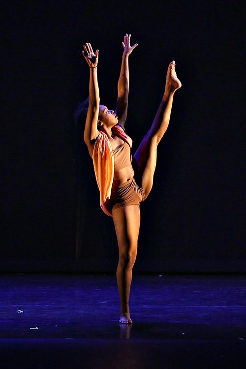 MTSU senior dance major Jordyn Hill of Knoxville, Tennessee, reaches skyward on the Tucker Theatre stage during the 2019 Fall Dance Concert in this file photo. The MTSU Dance Theatre will present its 2020 Fall Dance Concert Saturday, Nov. 21, via video at the program's Facebook page: https://www.facebook.com/mtsu.dance. (Photo by Martin O'Connor)