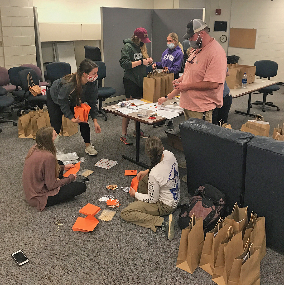 """Members in instructor Alanna Vaught's MTSU agritourism class collect items they placed in 80 """"Harvest Handbags"""" for first graded students at Homer Pittard Campus School, a part of Rutherford County Schools and partner with MTSU for more than 90 years. (Photo by Max Lafrenier)"""