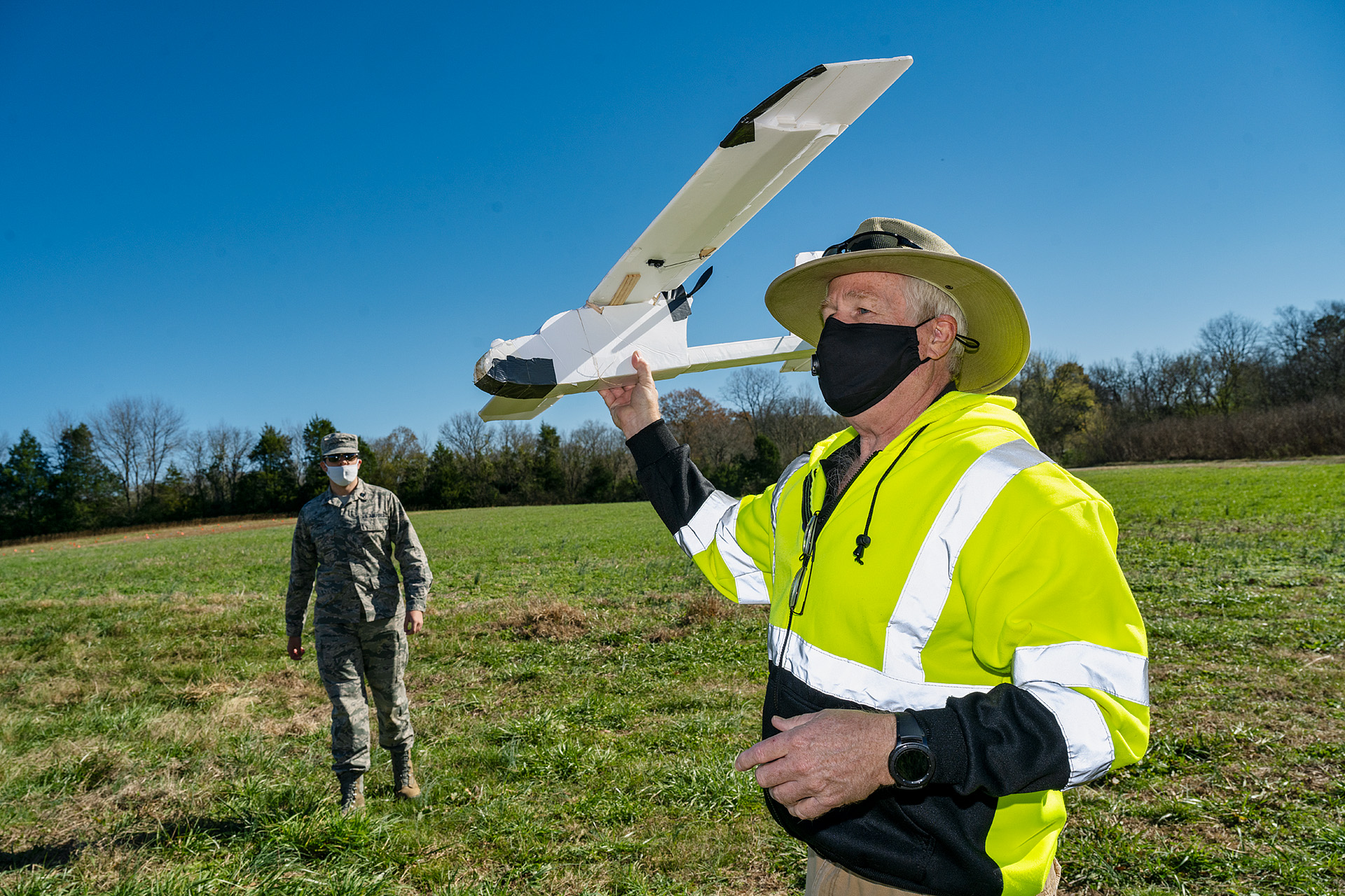Kevin Corns, assistant professor in the Department of Aerospace, is shown with students flying their Unmanned Aircraft Systems drones at the MTSU Farm in Lascassas, Tenn. He said this is a fixed-wing drone they built in an upper-division UAS Operations program class. (MTSU photo by Andy Heidt)