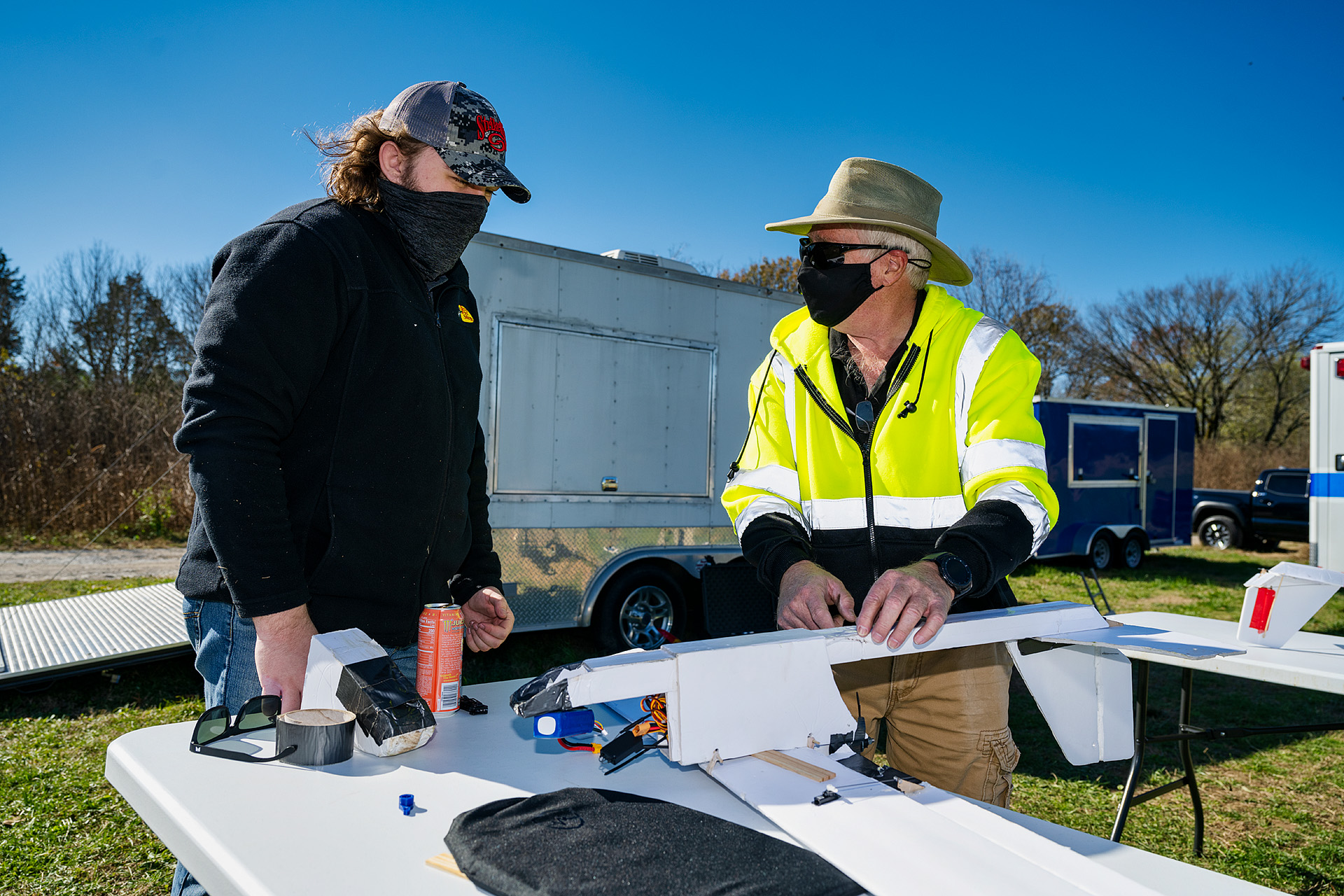 Kevin Corns, Aerospace faculty, with students flying their Unmanned Aerial System aircraft at the MTSU Farm. Brian Liddle (Jr.) left, with Kevin Corns, Aerospace faculty. (Photo: Andy Heidt)