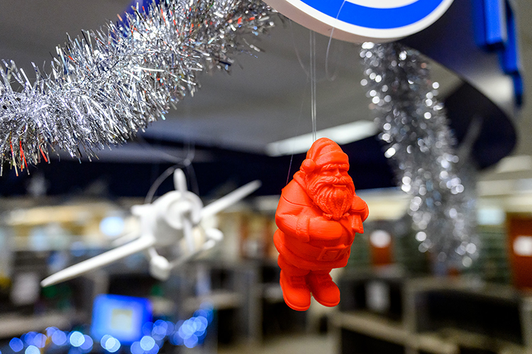 Santa Claus is watching over Makerspace in the James E. Walker Library to make sure COVID-19 protocols are observed. Many of the popular figurines that once adorned the help desk have been suspended from on high in order to prevent people from handling them. (MTSU Photo by J. Intintoli)