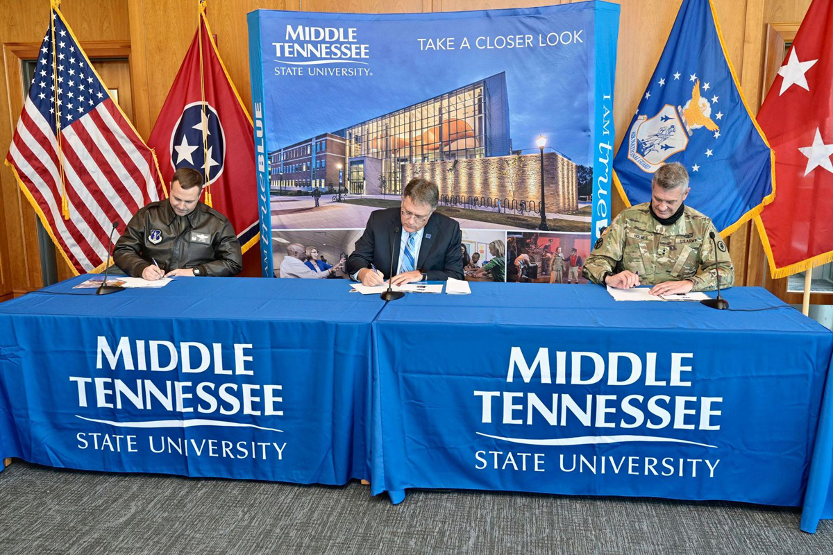 118th Wing Commander Col. Todd A. Wiles, left, MTSU Provost Mark Byrnes and Tennessee Adjutant General Maj. Gen. Jeff Holmes sign the memorandum of understanding, leading to a partnership between the university and the Wing. The signing, which took place Tuesday, Nov. 3, in the Student Union Building's President's Conference Room, emphasizes collaborative training and research initiatives, including unmanned aerial systems operations and computer science. (MTSU photo by Andy Heidt)