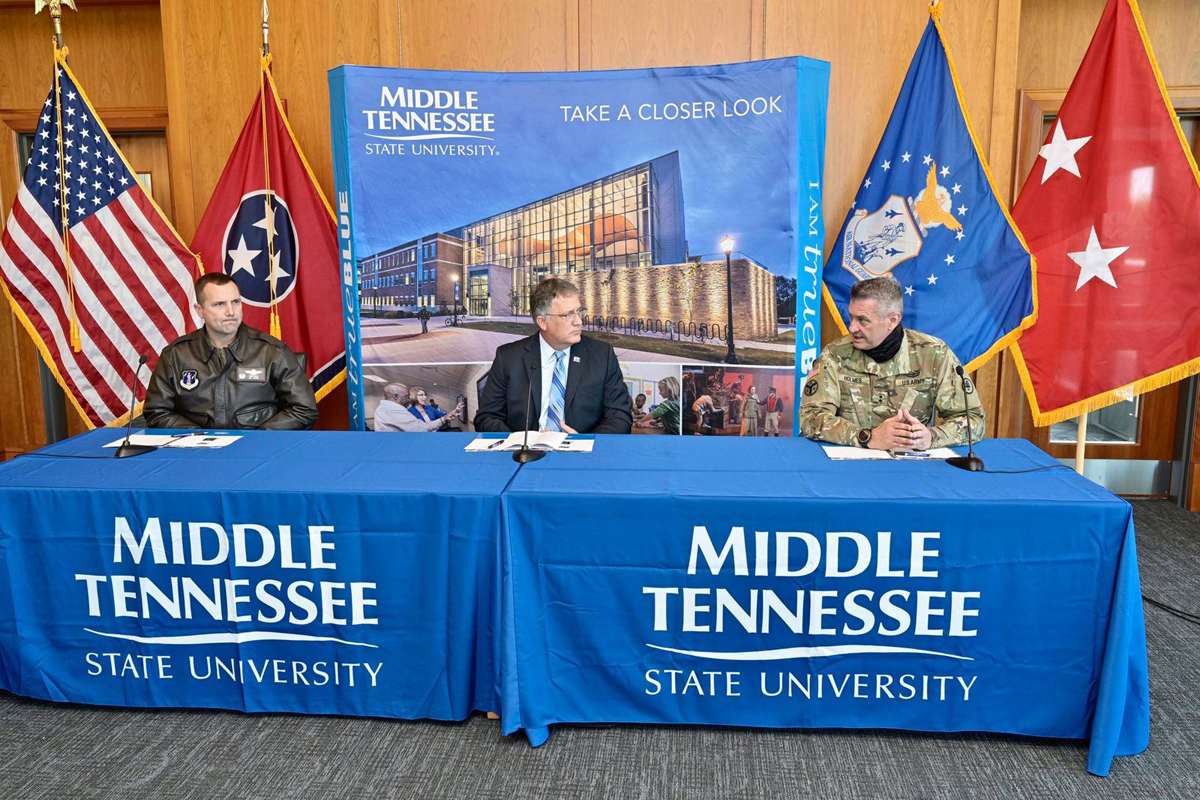Wing Commander Todd A. Wiles, left, MTSU Provost Mark Byrnes and Tennessee Adjutant General Maj. Gen. Jeff Holmes discuss the merits of the new partnership that potentially will include unmanned aerial systems operations and computer science collaborative and research initiatives Tuesday, Nov. 3, in the Student Union Building's President's Executive Conference Room. (MTSU file photo by Andy Heidt)