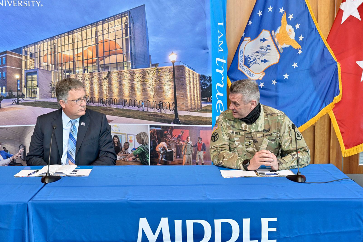 U.S. Army Maj. Gen. Jeff Holmes, right, discusses a computer science and unmanned aircraft systems operations research collaboration with MTSU Provost Mark Byrnes in early November in the President's Conference in the Student Union Building. Holmes, a former MTSU student, will be recognized as the 2021 Hero in March by the American Red Cross Heart of Tennessee Chapter. (MTSU file photo by Andy Heidt)