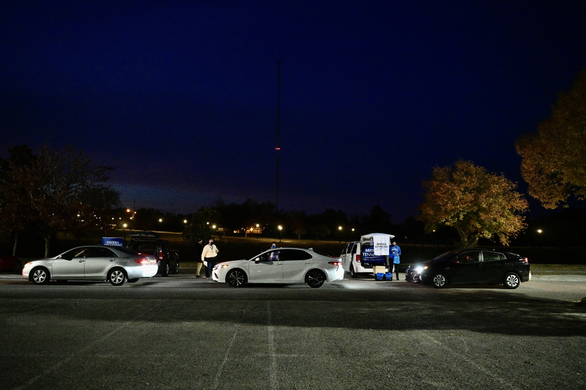 As darkness settles in, cars carrying prospective students participate in the MTSU Drive-Thru College Fair in the Rutherford Parking Lot Thursday, Nov. 5. The event was a way for high school students to learn more about MTSU and other colleges since COVID-19 forced the cancellation of college fairs across the state. (MTSU photo by Andy Heidt)