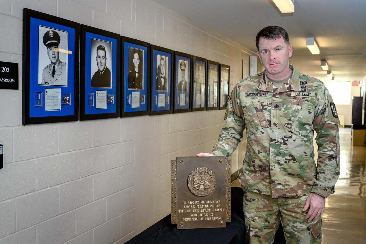 U.S. Army Lt. Col. Carrick McCarthy, who heads the MTSU Military Science program, is shown with a group of eight shadowbox photo displays of former university ROTC cadets who died in combat while serving their country, and an accompanying plaque in Forrest Hall. The shadowboxes will be on display from 12:30 to 2:30 p.m. Saturday, Nov. 7, at the Veterans Memorial outside the Tom H. Jackson Building, 628 Alma Mater Drive, leading to the 39th annual Salute to Veterans and Armed Services game between MTSU and Charlotte in Floyd Stadium. This marks the 70th anniversary of the program. (MTSU photo by J. Intintoli)